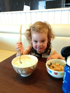 Eden enjoying her huge bowl of rice!