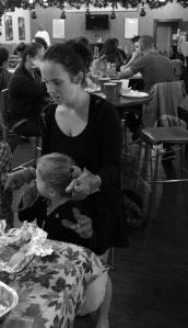 Eden helping serve dinner