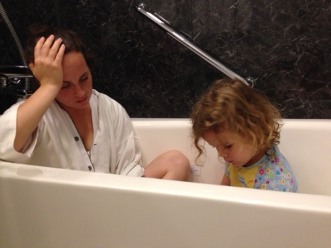 Hannah & Eden watching a movie in the bath