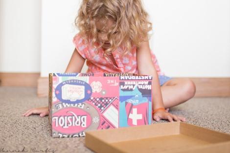 Peeking inside her box of postcards
