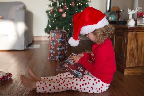 Eden opening her present from Clio