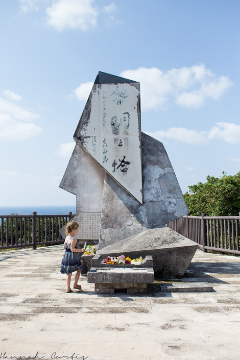 Eden laying the flowers on the Okinawa memorial