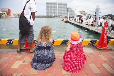 the girls watching the kids getting in/out of the dragon boats