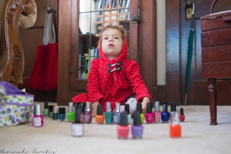 Clio sorting out her cousins nail polishes