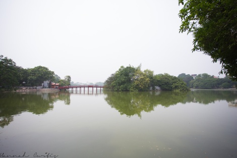 view of the bridge leading to the tiny island/Ngoc Son Temple