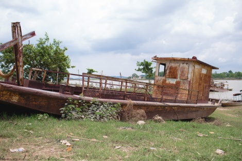 rusty old boat at the river where we had to cross