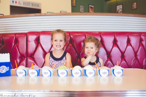 The girls excited to dig into the 8 scoops of ice-cream (that's Clio's peace sign)